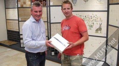 Ceramic Tile Merchants presents competition winner with iPad